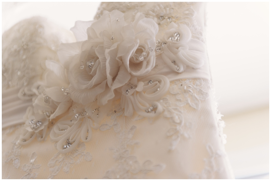 flower detail on lace wedding dress