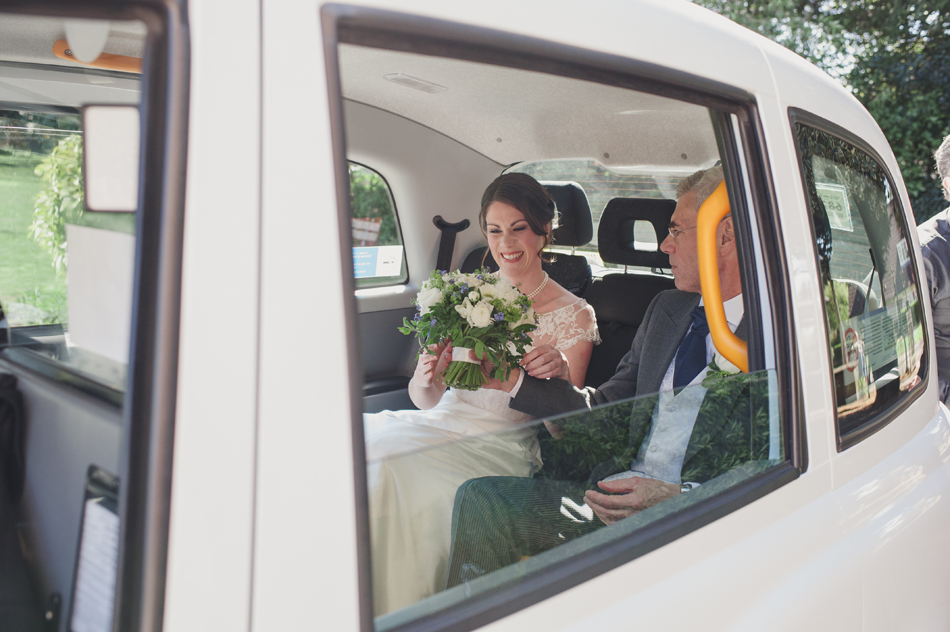 bride arriving in white London Taxi Cab